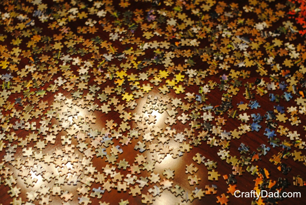 Dining Room Table Full of Puzzle Pieces